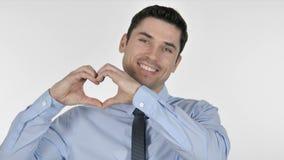 由年轻商人的手工制造心脏在白色背景 股票录像