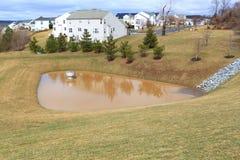 防洪的风暴池塘 免版税库存照片