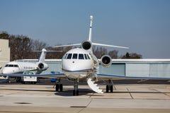 由挂衣架的两个私人喷气式飞机 图库摄影