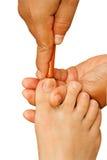 由木棍子的泰国温泉脚治疗 免版税图库摄影