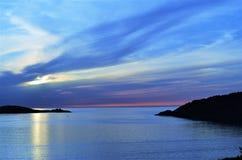 由海的日落在早期的春天 库存照片