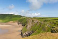 由海滩的罗西里海岸和蠕虫朝向Gower半岛南威尔士英国 免版税库存图片