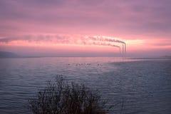 由湖的工业风景 免版税库存照片