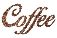 由烤咖啡豆做的咖啡标题 库存图片