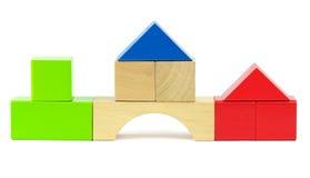 由玩具木积木做的议院 免版税库存照片