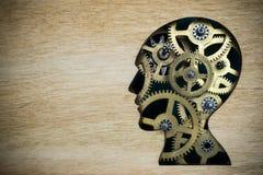 由生锈的金属齿轮做的脑子模型 免版税图库摄影