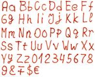由番茄酱做的字母表信件 库存照片