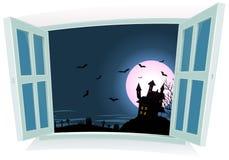 由窗口的万圣夜风景 免版税库存照片