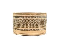 由竹子做的篮子在与裁减路线的白色背景 库存照片