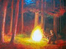 由篝火的人在森林里 免版税库存照片