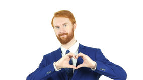 由红色头发胡子商人,白色背景的心脏标志 免版税库存图片