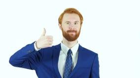 由红色头发胡子商人,白色背景的赞许 影视素材