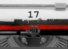 17由老打字机的数字在白皮书 库存照片