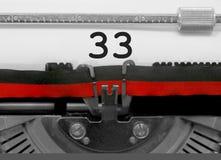 33由老打字机的数字在白皮书 免版税图库摄影