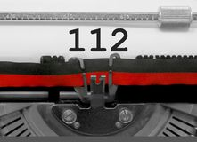 112由老打字机的数字在白皮书 免版税库存图片