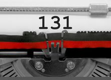 131由老打字机的数字在白皮书 库存照片