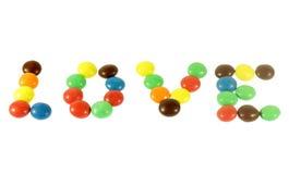 由色的糖果做的词爱 库存照片