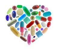 由药片做的心脏形状 库存照片