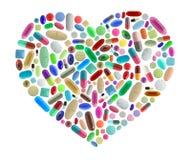 由药片做的心脏形状 免版税库存照片