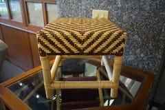 由藤条做的椅子集合编织品 免版税库存图片