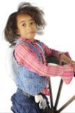 由轮子的年轻女牛仔 免版税图库摄影
