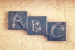 由金属信件做的阶段ABC 图库摄影