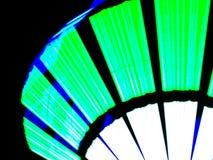 由长的快门速度的被阐明的绿色霓虹灯设计 免版税库存照片