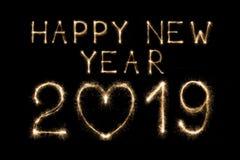 由闪烁发光物烟花光做的新年好2019文本被隔绝在黑背景 免版税库存图片