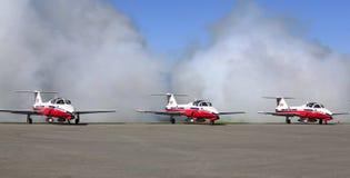 由雪鸟的显示合作在飞行表演事件 免版税库存图片