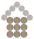 由香港硬币做的家 库存照片