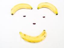 由香蕉和扁豆香蕉做的微笑的面孔 免版税图库摄影