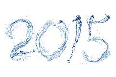 由水下落的新年快乐2015年 库存图片
