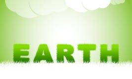 由绿草的地球标题 免版税库存图片