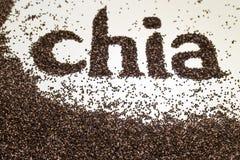 由chia做的Chia词播种在白色背景的Salvia hispanica 免版税库存图片