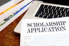 申请表格桌面奖学金 免版税图库摄影