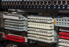 电信折磨与接线板和电话distribut 免版税图库摄影