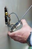 电力输出维修服务墙壁 免版税库存照片