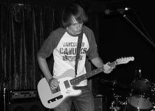 电吉他人使用 免版税图库摄影