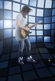 电女孩吉他作用  免版税库存图片