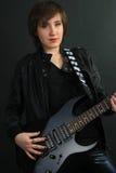 电女孩吉他皮革成套装备岩石 库存照片