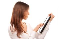 电子填充片剂接触键入妇女 图库摄影