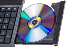 电子收藏-有开放DVD盘子的膝上型计算机 免版税库存图片