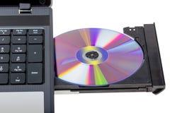 电子收藏-有开放DVD盘子的膝上型计算机 库存图片