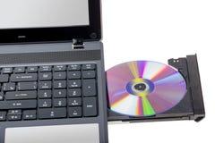 电子收藏-有开放DVD盘子的膝上型计算机 免版税库存照片