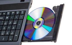 电子收藏-有开放DVD盘子的膝上型计算机 免版税图库摄影