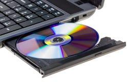 电子收藏-有开放DVD盘子的膝上型计算机 库存照片