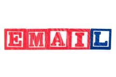 电子邮件-字母表在白色的婴孩块 免版税库存照片