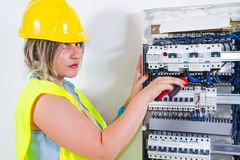 电工电评定的工作 库存照片