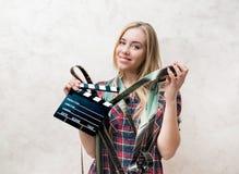 电影与影片和拍板的学生画象 库存照片