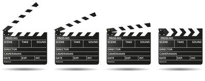 电影在白色隔绝的拍板 库存照片